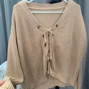 Ribbed lace up sweater